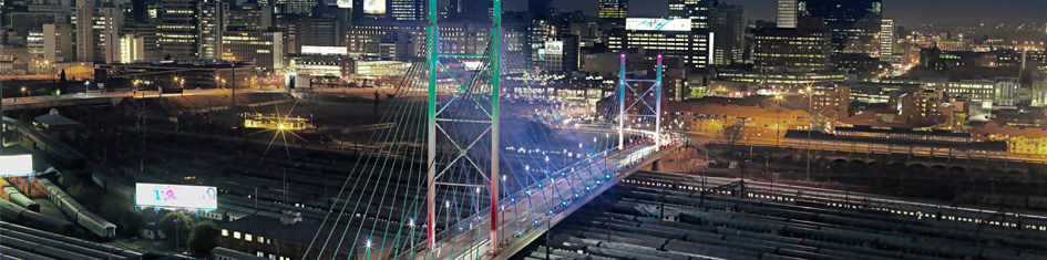 Gauteng cars at night with bridge