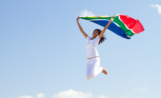 lady jumping with south african flag