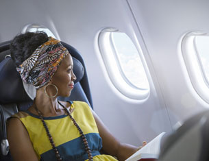 woman sitting by plane window