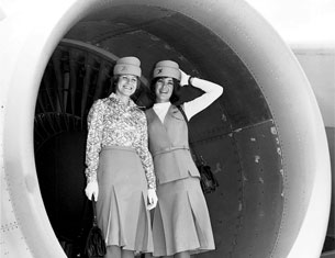 Ladies posing in front of turbine