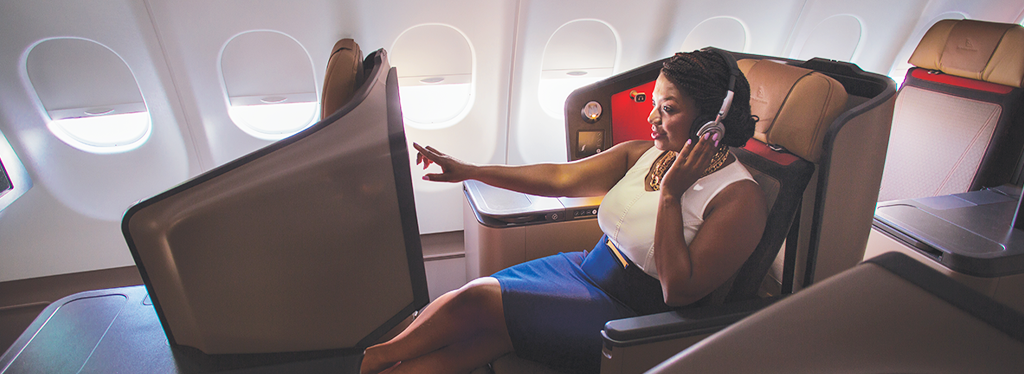 Woman relaxing in business class