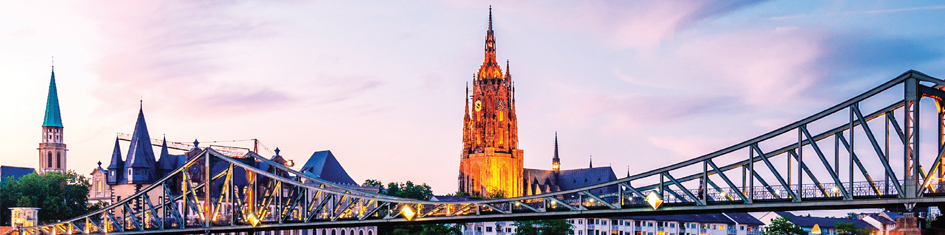 View of bridge and city of Frankfurt at sunset