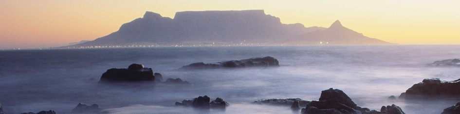 Sunset view of Table Mountain and the sea in Cape Town