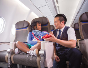 flight attendant giving girl chips